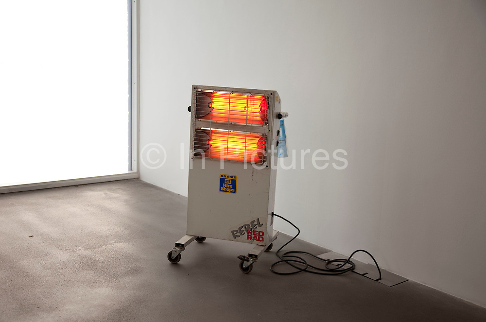 Portable fire heats up the Gagosian Gallery in London. Adding some extra warmth to the space bathed in light.