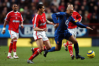 Photo: Javier Garcia/Back Page Images<br />Charlton Athletic v Arsenal, FA Barclays Premiership, The Valley 01/01/2005<br />Thierry Henry is tracked by Charlton scorer Talal El Kalkouri