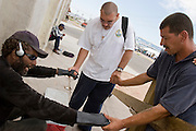 07 AUGUST 2005 - PHOENIX, AZ: EDDIE, left, a homeless person in Phoenix, prays with MIKE, center, and DUANE, both from the Church of the Street shelter in central Phoenix, Sunday. Members of the Church of the Street walk through downtown Phoenix praying with the homeless.  PHOTO BY JACK KURTZ