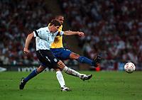 Photo: Tony Oudot.<br /> England v Brazil. International Friendly. 01/06/2007.<br /> Steven Gerrard of England clears from Gilberto Silva of Brazil