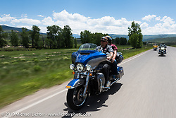 Cecil Harris and Susan Starlin of Hutchinson, KS on their 2017 Ultra Limited riding from Steamboat Springs to Doc Holliday's Harley-Davidson in Glenwood Springs during the Rocky Mountain Regional HOG Rally, Colorado, USA. Thursday June 8, 2017. Photography ©2017 Michael Lichter.