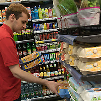 Salesman adjusts egg products on the selves before the official opening ceremony of a new Spar food shop in downtown Budapest, Hungary on Aug. 22, 2018. ATTILA VOLGYI