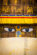 Close up of Buddha's eyes, Chabahil Stupa (Buddhist Shrine) with Prayer Flags, Kathmandu