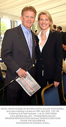 SARAH, MARCHIONESS OF MILFORD-HAVEN and MR PETER BURRELL, at a race meeting in Surrey on 25th April 2003.PJD 154