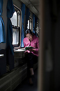 A woman reads on a train in Sichuan Province.