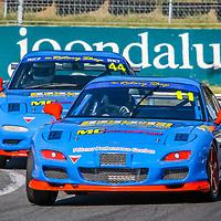 Kerry Wade (11 - Mazda RX7) leads Matt Cherry (44 - Mazda RX7) onto the main straight at Wanneroo Raceway.