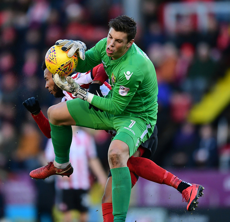Stevenage's Joe Fryer claims the ball under pressure from Lincoln City's Matt Green<br /> <br /> Photographer Chris Vaughan/CameraSport<br /> <br /> The EFL Sky Bet League Two - Lincoln City v Stevenage - Tuesday 26th December 2017 - Sincil Bank - Lincoln<br /> <br /> World Copyright © 2017 CameraSport. All rights reserved. 43 Linden Ave. Countesthorpe. Leicester. England. LE8 5PG - Tel: +44 (0) 116 277 4147 - admin@camerasport.com - www.camerasport.com