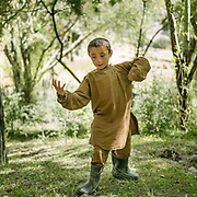 Kids picking wood in planted forest. The traditional life of the Wakhi people, in the Wakhan corridor, amongst the Pamir mountains.