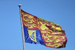 The Royal Standard flying above Windsor Castle before the annual Order of the Garter Service at St George's Chapel, Windsor Castle.