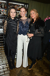 Left to right, DAISY BATES, TIPHAINE DE LUSSY and AZZI GLASSER at the Lancôme BAFTA Dinner held at The Cafe Royal, Regent's Street, London on 6th February 2015.