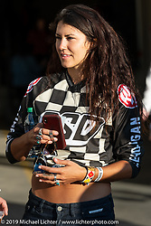 Kelly Yazdi was working the Revival and Roland Sands sponsored races including the Super Hooligan main attraction, all which that took place on a tight TT race course set up in the parking lot of the Austin American Statesman drew crowds outside during the Handbuilt Show. Austin, Texas USA. Saturday, April 13, 2019. Photography ©2019 Michael Lichter.