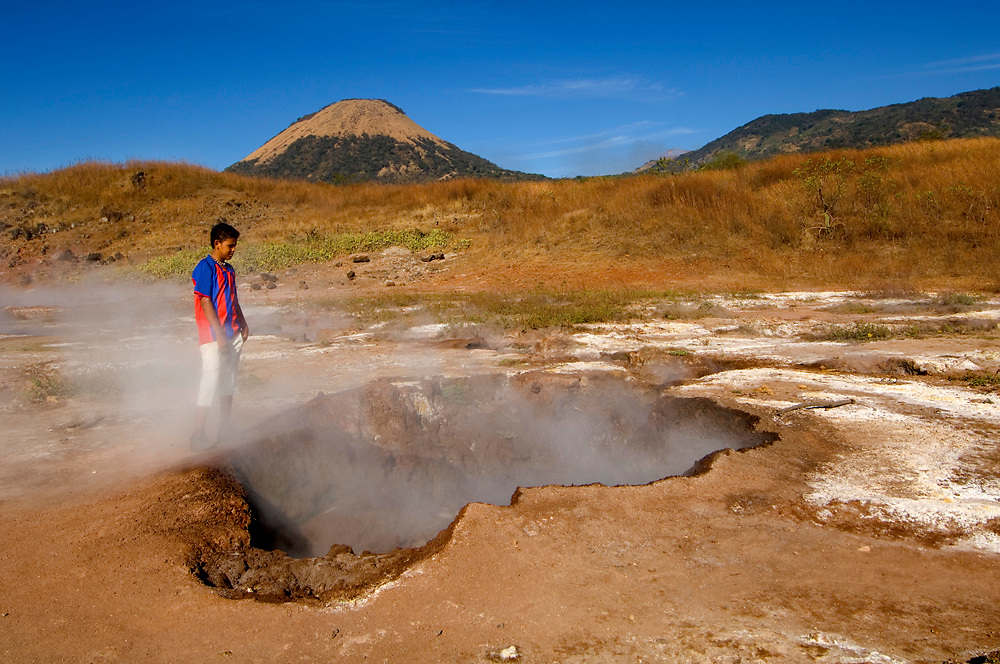 Young boy acts as a tourist guide to the Hervideros de San Jacinto, a field of boiling mud holes connected to the Telica Volcano in San Jacinto, Nicaragua.
