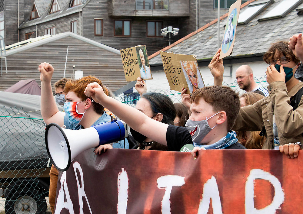 Protesters march past the Media centre in Flmouth, Cornwall, as part of the Climate Strike, ahead of the G7 Summit happening at the weekend. 11th June 2021.  Anna Hatfield/Pathos
