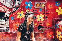 A young woman takes a wet and dusty break during Songkran, the Thai New Year, in Bangkok, Thailand. Traditionally, the festivities are rooted in the zodiac calendar, when the sun enters the sign of Aries. Songkran is a time of cleansing and renewal. Hence the water. But what was once a means of washing Buddha statues and the hands of elders has now turned into a nationwide water fight.