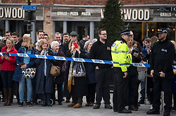 © Licensed to London News Pictures. 15/03/2018. Salisbury, UK. Members of the public wait behind police tape to see British Prime Minister Theresa May, as she visits Salisbury, Wiltshire where Former Russian spy Sergei Skripal and his daughter Yulia were found after being poisoned with nerve agent. The couple where found unconscious on bench in Salisbury shopping centre. A policeman who went to their aid is currently recovering in hospital. Photo credit: Ben Cawthra/LNP