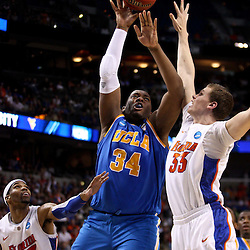 Mar 19, 2011; Tampa, FL, USA; UCLA Bruins center Joshua Smith (34) shoots over Florida Gators forward Erik Murphy (33) during second half of the third round of the 2011 NCAA men's basketball tournament at the St. Pete Times Forum. Florida defeated UCLA 73-65.  Mandatory Credit: Derick E. Hingle