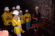 Guide showing drill device in old copper mine, Queen Mine tour, Bisbee, Arizona.©1994 Edward McCain.  All rights reserved.  McCain Photography, McCain Creative, Inc.