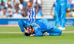 Virat Kohli (capt.) of India twists back on himself holding his head showing his frustration having missed a run out opportunity on Quinton de Kock (wk) of South Africa