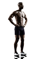 one young african muscular build man standing topless silhouette isolated on white background