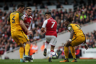 Alexis Sanchez of Arsenal © back heels the ball for a goal assist to Alex Iwobi of Arsenal (not pictured)  to score the 2nd goal.<br /> Premier league match, Arsenal v Brighton & Hove Albion at the Emirates Stadium in London on Sunday 1st October 2017. pic by Kieran Clarke, Andrew Orchard sports photography.