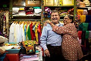 Purushottam Goyal, left, and his wife Saroj Goyal at the Dress Shoppe II, an Indian textiles store in East Village on July 29, 2016, in New York City, New York. The two have been married for 46 years and have been running the shop together for 38 years.