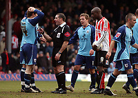 Photo: Olly Greenwood.<br />Brentford v Barnsley. Coca Cola League 1. 11/03/2006. Barnsley players can't beleive it as referee Mr P Miller gives a penalty.