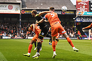AFC Wimbledon Forward James Hanson (18) and Luton Town Defender Sonny Bradley (5) in action during the EFL Sky Bet League 1 match between Luton Town and AFC Wimbledon at Kenilworth Road, Luton, England on 23 April 2019.