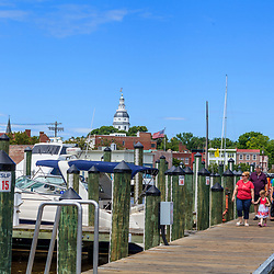 Annapolis, MD, USA - May 20, 2012: People walking on the dock at the Annapolis Harbor