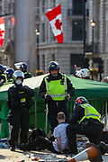 "Police arrest a protestor during a ""Resist and Act for Freedom"" protest against a mandatory coronavirus vaccine, wearing masks, social distancing and a second lockdown, nearby Canada House in Trafalgar Square, London on Saturday, Sept. 19, 2020. The event, which began at noon, drew a broad coalition including coronavirus sceptics, 5G conspiracy theorists and so-called ""anti-vaxxers"". Speakers at the event accused the government of attempting to curtail civil liberties. (VXP Photo/ Vudi Xhymshiti)"