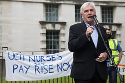 John McDonnell, Labour MP for Hayes and Harlington, addresses NHS workers and supporters at a protest rally opposite Downing Street as part of a national day of action to mark the 73rd birthday of the National Health Service on 3rd July 2021 in London, United Kingdom. The protesters called for fair pay for NHS workers, for better funding of the NHS and for an end to privatisation measures affecting the NHS.