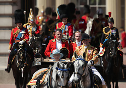 Queen Elizabeth II makes her way down The Mall from Buckingham Palace, central London to Horse Guards Parade for the Trooping the Colour ceremony as the Queen celebrates her official birthday today.
