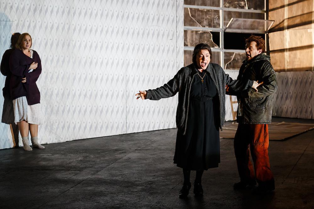 "LONDON, UK, 21 June, 2016. Left to right: Laura Wilde (as Jenufa), Michaela Martens (as Kostelnicka Buryja) and Peter Hoare (as Laca Klemen) rehearse for the revival of director David Alden's production of Janacek's opera ""Jenufa"" at the London Coliseum for the English National Opera. The production opens on 23 June. Photo credit: Scott Rylander."