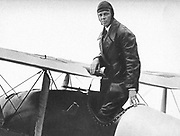 Charles Lindbergh (1902-1974) in his flying kit standing in 'Spirit of St Louis', the plane in which he made the first non-stop Atlantic air  crossing: 20-21 May 1927. Landed at Le Bourget Airdrome, Paris, after a flight of 33.5 hours.
