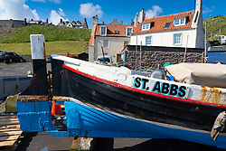 Old fishing boat on quayside at St Abbs in Scottish Borders, Scotland, UK
