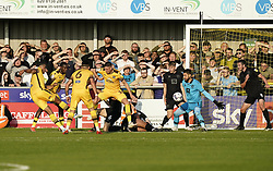 Sutton United's Coby Rowe (left) scores the winning goal during the Sky Bet League Two match at Borough Sports Ground, Sutton. Picture date: Saturday October 9, 2021.