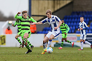 Forest Green Rovers Charlie Cooper(20) challenges Chester's Ryan Lloyd(21) during the FA Trophy 2nd round match between Chester FC and Forest Green Rovers at the Deva Stadium, Chester, United Kingdom on 14 January 2017. Photo by Shane Healey.