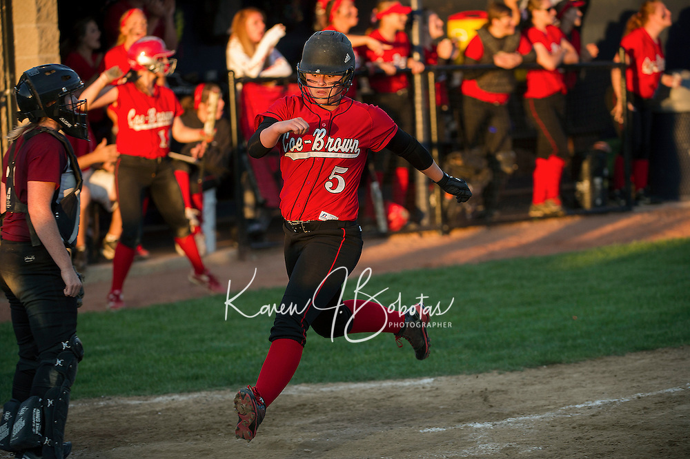 Coe Brown's Jessica Ohrenberger crosses home plate on a triple from Lauren Jones during NHIAA Division II Softball Tuesday evening.  (Karen Bobotas/for the Concord Monitor)