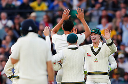 Australia's Peter Handscomb celebrates with Mitchell Starc after he took the catch to dismiss James Vince during day four of the Ashes Test match at the Adelaide Oval, Adelaide.