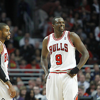 30 March 2012:  Chicago Bulls point guard C.J. Watson (7) and Chicago Bulls small forward Luol Deng (9) are seen during the Chicago Bulls 83-71 victory over the Detroit Pistons at the United Center, Chicago, Illinois, USA. NOTE TO USER: User expressly acknowledges and agrees that, by downloading and or using this photograph, User is consenting to the terms and conditions of the Getty Images License Agreement. Mandatory Credit: 2012 NBAE (Photo by Chris Elise/NBAE via Getty Images)