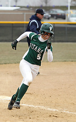 30 March 2013:  Audra James during an NCAA Division III women's softball game between the DePauw Tigers and the Illinois Wesleyan Titans in Bloomington IL<br /> <br /> Umpire in background is Mark Cable.