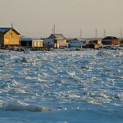 Houses along the edge of the Churchill river, Churchill, Manitoba.