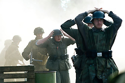 A Paratroopers from the 6th Airborne Division march German POWs away after a fire fight during a battle reenactment at Elsecar Heritage 1940's weekend - September 2010 <br /> Image © Paul David Drabble