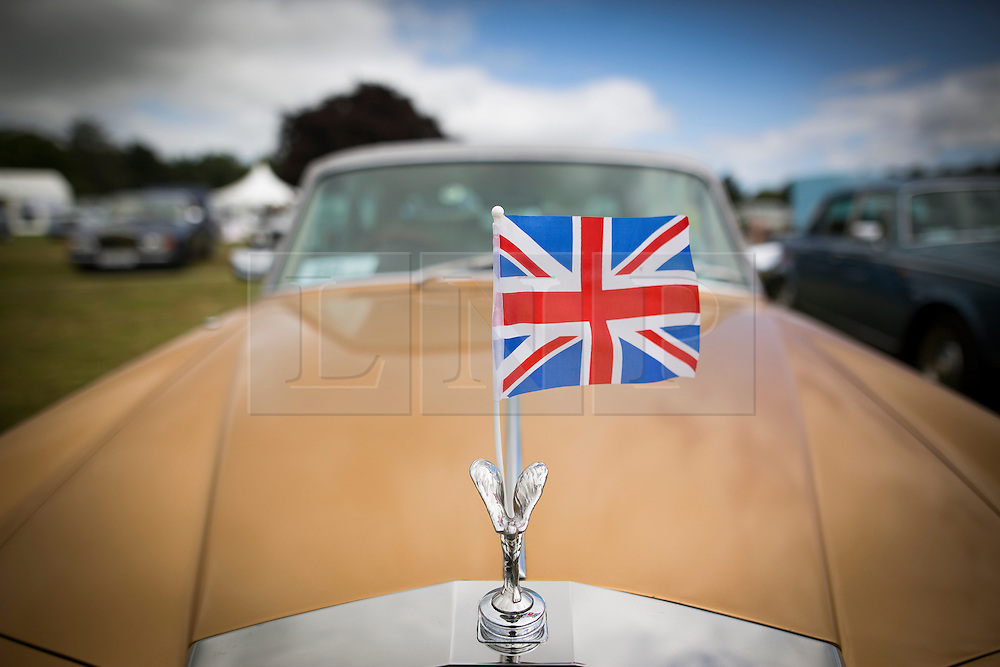 © Licensed to London News Pictures. 07/08/2016. Leeds UK. Picture shows a gold Rolls Royce Silver Shadow 2 at the 37th Rolls Royce North rally that has taken place this weekend in the ground's of Harewood House in Yorkshire. The event bring's together some of the UK's most prized motor cars & their proud owners. Photo credit: Andrew McCaren/LNP