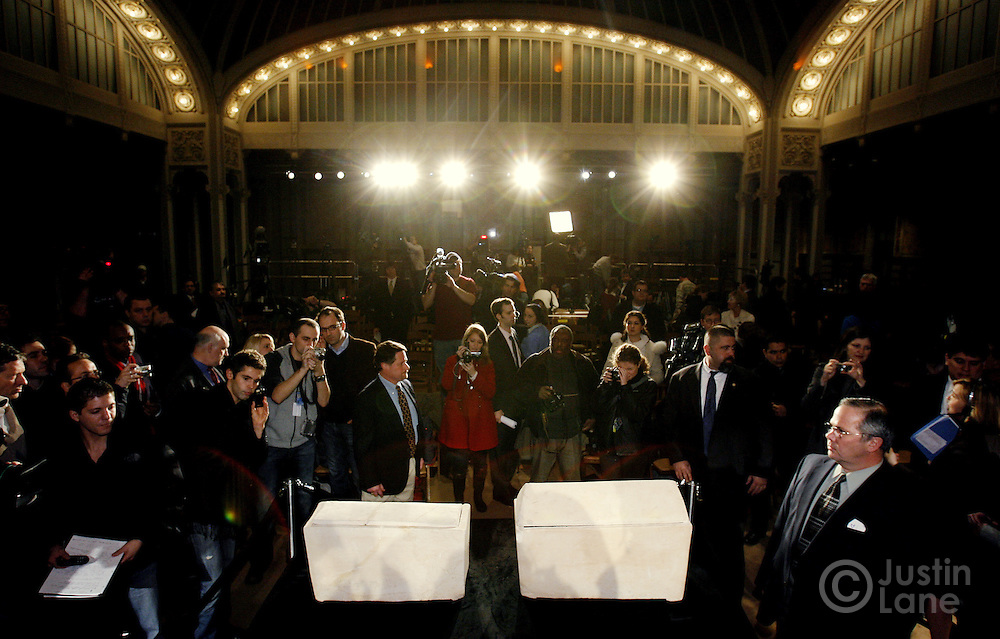 Members of the press are seen around two limestone ossuaries (bone boxes) that filmmakers Simcha Jacobovici and James Cameron allege may have belonged to Mary Magdalene, on right, and Jesus of Nazareth, on left, during a press conference at the New York Public Library about the discovery of a tomb in Jerusalem that may have held the remains of Jesus and his family in New York, New York on Monday 26 February 2007. The assertion, based on archeology and statistical  findings, will be airing in a documentary on the Discovery Channel called 'The Lost Tomb Jesus'.