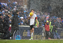 Ayr United's Paddy Boyle as snow falls during the William Hill Scottish Cup, fifth round match at Somerset Park, Ayr.