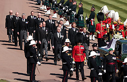 The Duke of York, the Duke of Cambridge, Peter Phillips, the Princess Royal, the Earl of Wessex, the Duke of Sussex, the Earl of Snowdon and Vice-Admiral Sir Timothy Laurence follow the Duke of Edinburgh's coffin, covered with his Personal Standard, on the purpose built Land Rover Defender outside St George's Chapel, Windsor Castle, Berkshire, ahead of the funeral of the Duke of Edinburgh. Picture date: Saturday April 17, 2021.