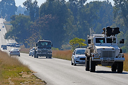 JOHANNESBURG, SOUTH AFRICA - MAY 08: An SANDF armoured Casspir on escort for food parcels on May 08, 2020 in Diepsloot, South Africa. In partnership with with government and Celebration Church, Engen Fuel Retailers contributed food parcels for over 4000 familes in Diepsloot during lockdown level 4. (Photo by Dino Lloyd)