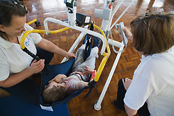 Child with physical disabilities in an exercise class,