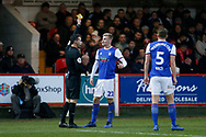 Referee Dean Whitestone shows a yellow card to Ipswich Town midfielder Flynn Downes (21)  during the The FA Cup 3rd round match between Accrington Stanley and Ipswich Town at the Fraser Eagle Stadium, Accrington, England on 5 January 2019.