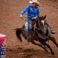 Barrel racer Nakona Danley rounds her first barrel during the Best of the Best rodeo at Red Rock Park in Gallup Wednesday.
